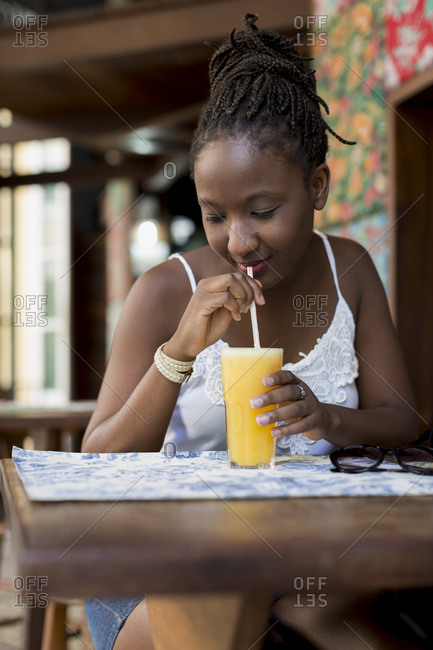 Brazilian woman having juice in Salvador de Bahia