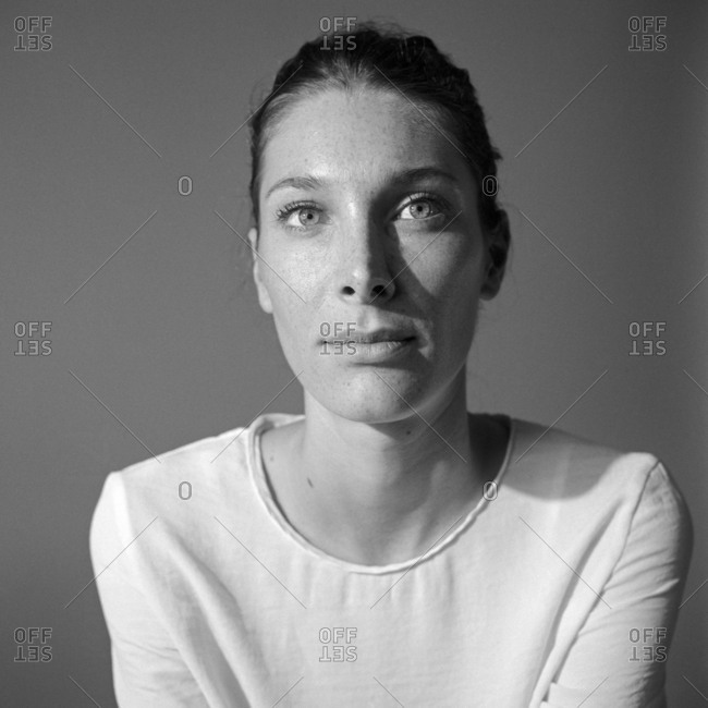 Portrait of Caucasian woman in simple white shirt