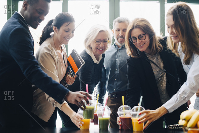 Business colleagues enjoying drinks during coffee break in conference