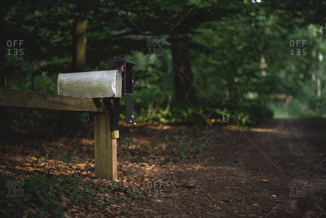 Wooden ledge of mailboxes on rural property