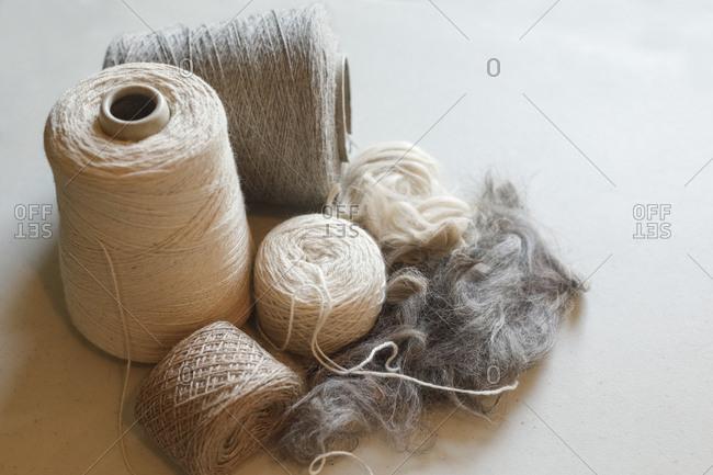 Spools of yarn made from alpaca fiber