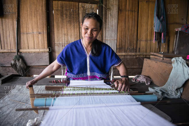 Chiang Mai, Thailand - February 15, 2018: Asian Karen woman sitting and weaving at Ban Pong Sayan