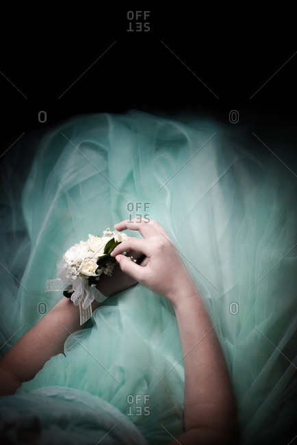 Young woman in formal dress wearing a corsage on her wrist