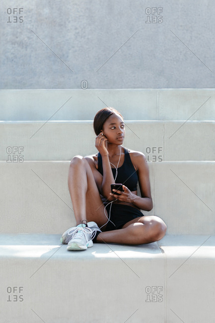 Young woman listening to music on mobile phone
