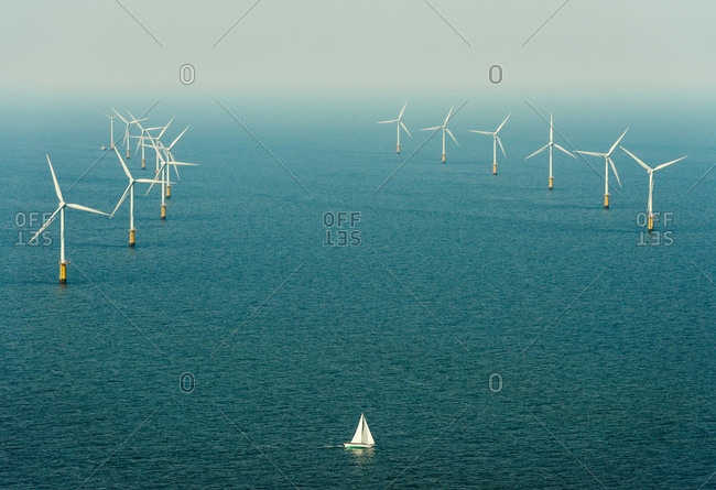 Sailing boat sails close to windfarm, IJmuiden, Noord-Holland, Netherlands