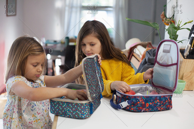 Sisters pack lunch for school