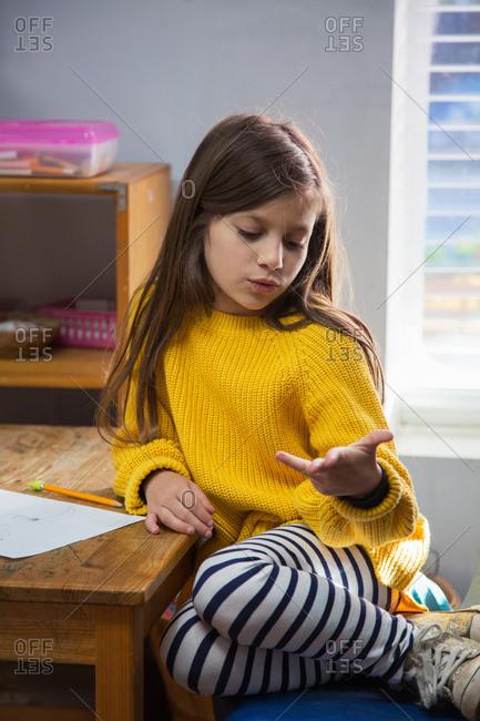 A girl in a classroom at a Montessori school
