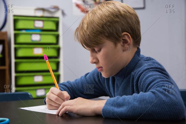 A boy in a classroom at school