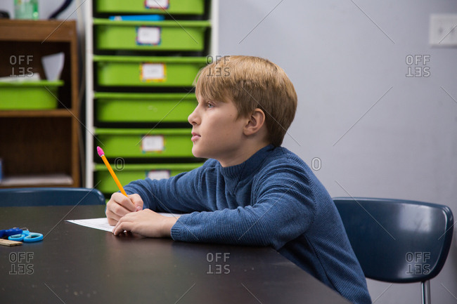 A boy in a classroom at school