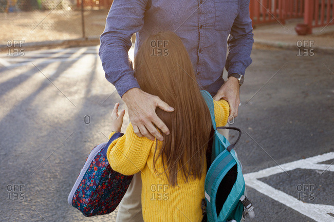 A mother hugs her child before they go to school