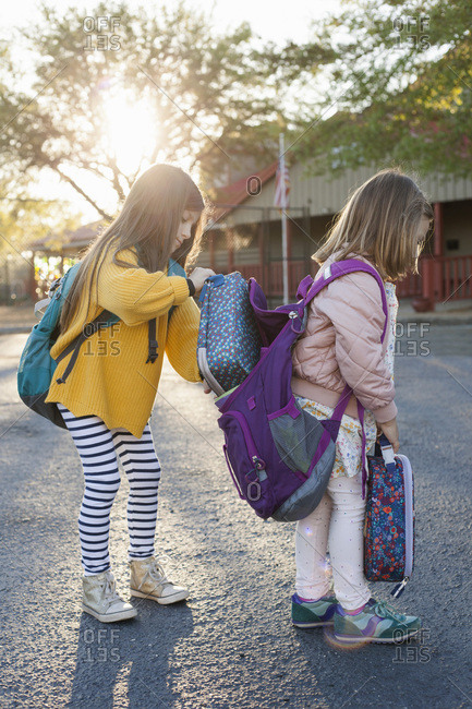 Sisters helping each other before school