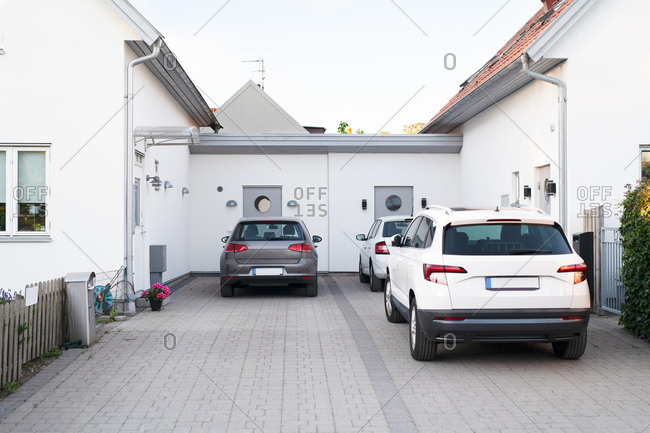 Cars parked in driveway
