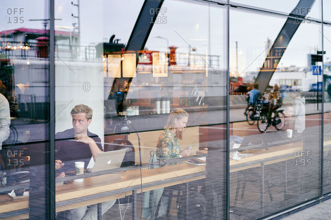 Amsterdam, Netherlands - June 12, 2018: People sitting in a cafe in Amsterdam Centraal station