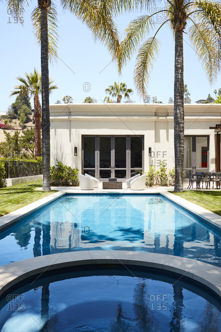 Beverly Hills, California - June 22, 2018: Poolside view of Beverly Hills home exterior