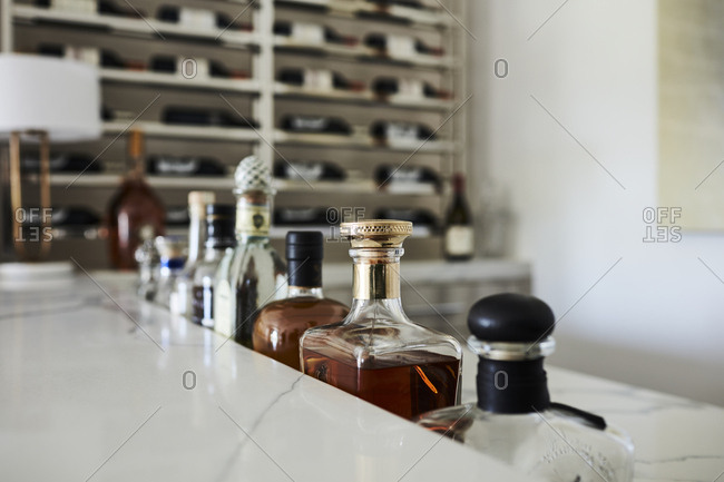 Beverly Hills, California - June 22, 2018: Liquor bottles on marble bar top in California home