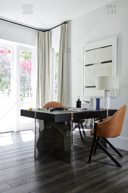 Beverly Hills, California - June 22, 2018: Modern office space with view to sunny garden in California home
