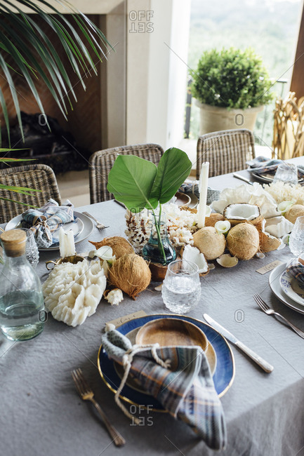 Tropical beach place setting with coral and shells