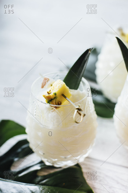 White cocktail in ornate glass