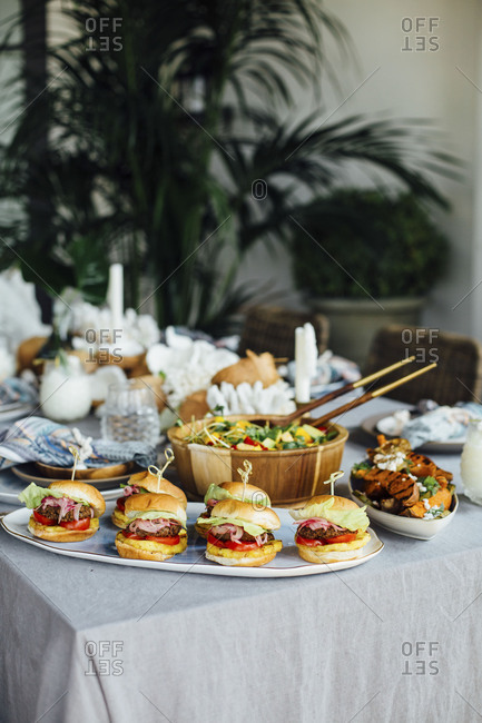 Sliders and salad on table