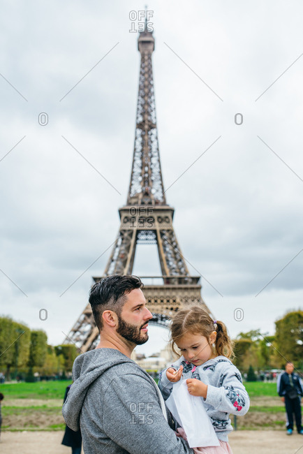 Father holding his daughter at the Eiffel tower, Paris