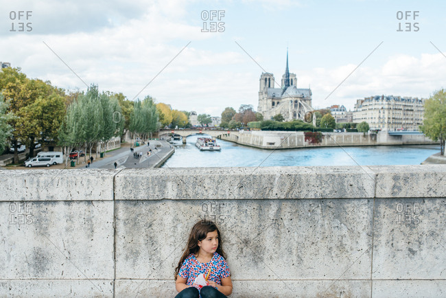 Girl with an Eiffel tower toy on a bridge, Paris