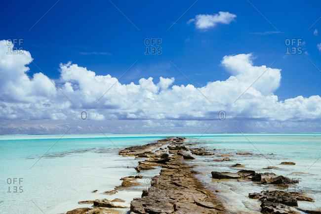 Cloudy skies over turquoise waters, Aitutaki, Cook Islands