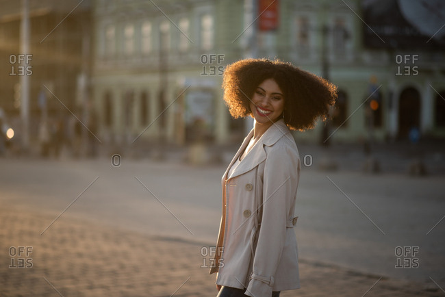 Young African-American teen walking in street in the evening