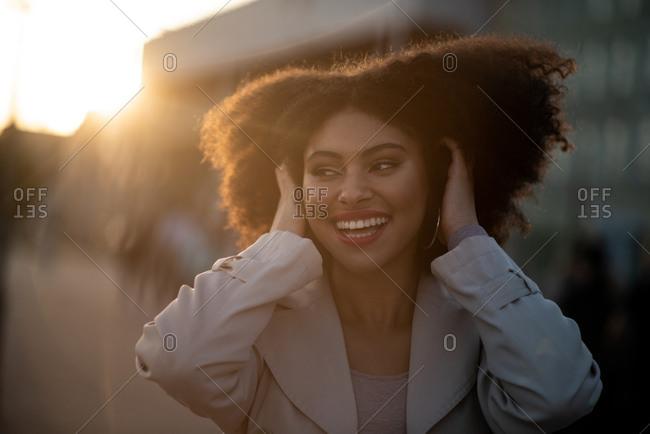 Smiling teen looking away at sunset