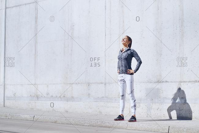 Female jogger enjoying sunny day during urban workout