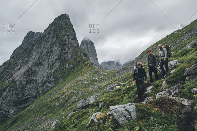 Norway- Lofoten- Moskenesoy- Young men hiking at Markan mountain