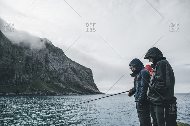 Norway- Lofoten- Moskenesoy- Young men fishing at Horseid Beach