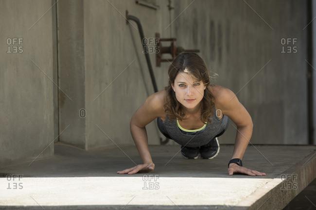 Woman doing push ups outdoor