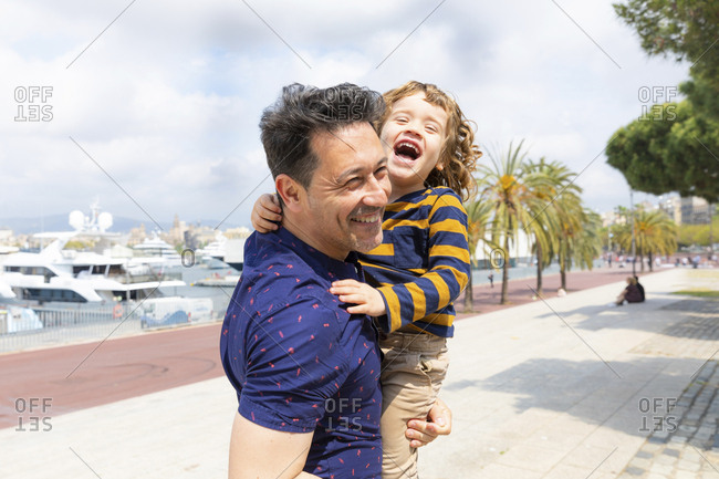 Spain- Barcelona- father and son playing together and having fun