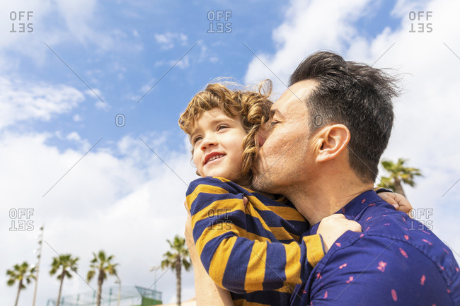 Spain- Barcelona- father kissing son on the beach
