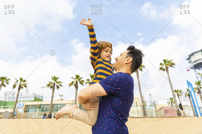 Spain- Barcelona- happy father and son on the beach