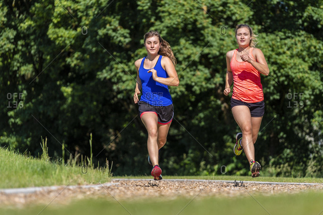 Female joggers on woodchip trail