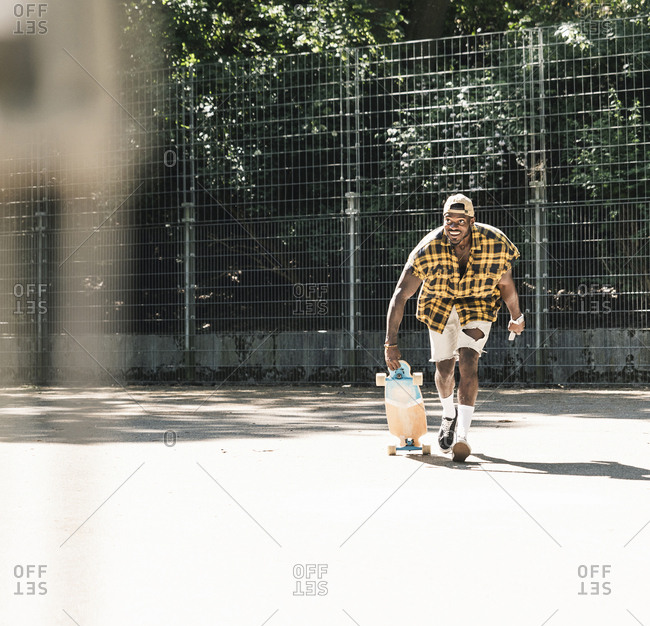 Cool young man in skateboarding skate park