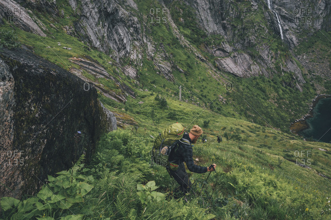 Norway- Lofoten- Moskenesoy- Man hiking downhill