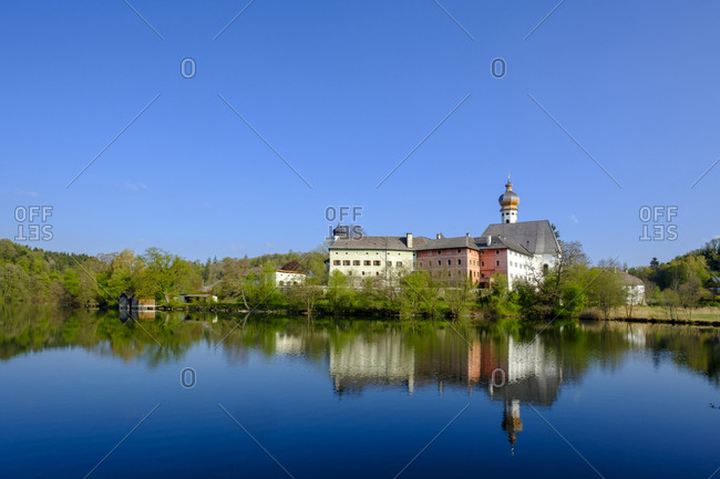 Germany- Bavaria- Upper Bavaria- Chiemgau- Rupertigau- Rupertiwinkel- Anger- View to former Hoeglwoerth Abbey and lake