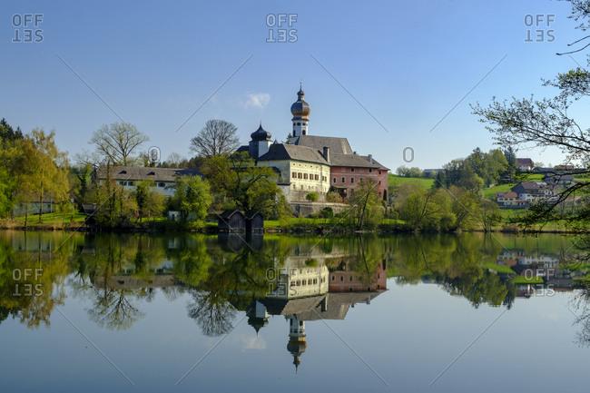 Germany- Bavaria- Upper Bavaria- Chiemgau- Rupertigau- Rupertiwinkel- Anger- View to former Hoeglwoerth Abbey and lake