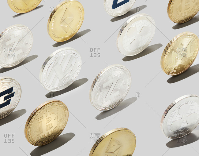 Rows of gold and silver cryptocurrency coins
