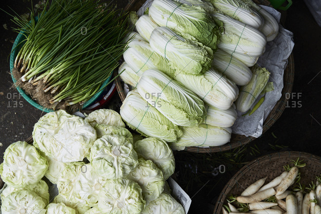 Hue, Vietnam - January 26, 2018: Lettuce, spring onion and turnips from above