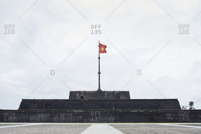 Memorial monument with vietnamese flag in the Imperial old city
