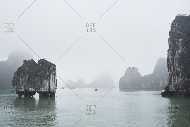 Ha Long Bay minimal landscape in cloudy and foggy day