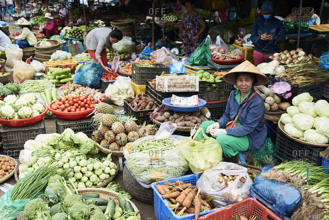 Hue, Vietnam - January 26, 2018: View of food market of Dong Ba with many fresh fruit and vegetables and few clandestine sellers