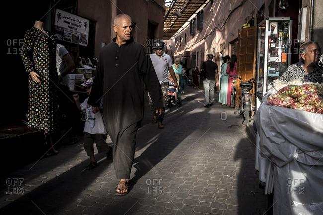 Marrakech, Morocco - September 16, 2017: Man walking in the medina of Marrakech