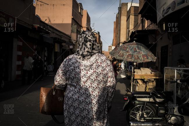 Marrakech, Morocco - September 16, 2017: Woman walking in the medina of Marrakech