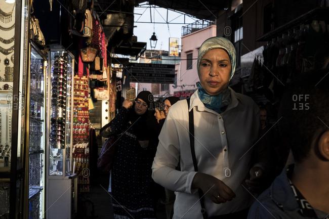 Marrakech, Morocco - September 16, 2017: People walking through the souks of Marrakech