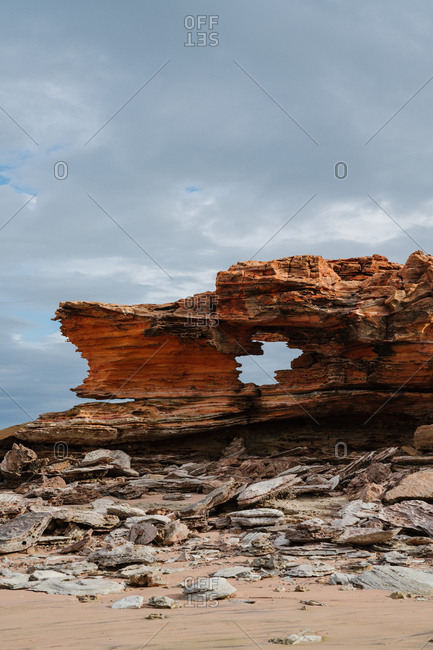 Stones and rock formation on stormy beach