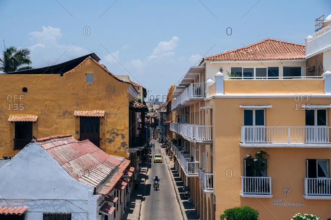 Slightly elevated view of narrow city street between buildings